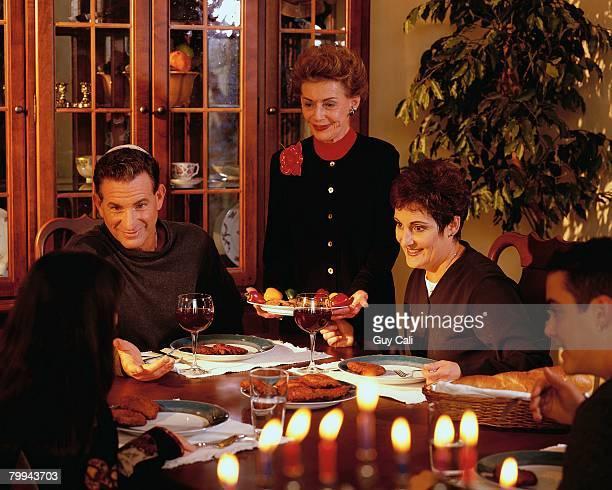Family at Hanukkah Dinner Table