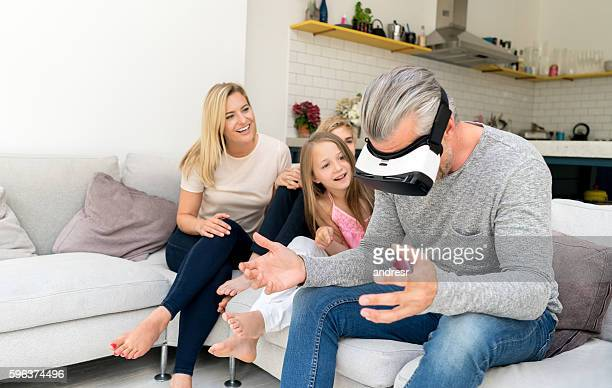 Family at home trying a VR device
