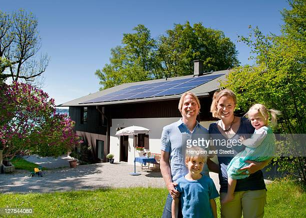Family at home with solar panel