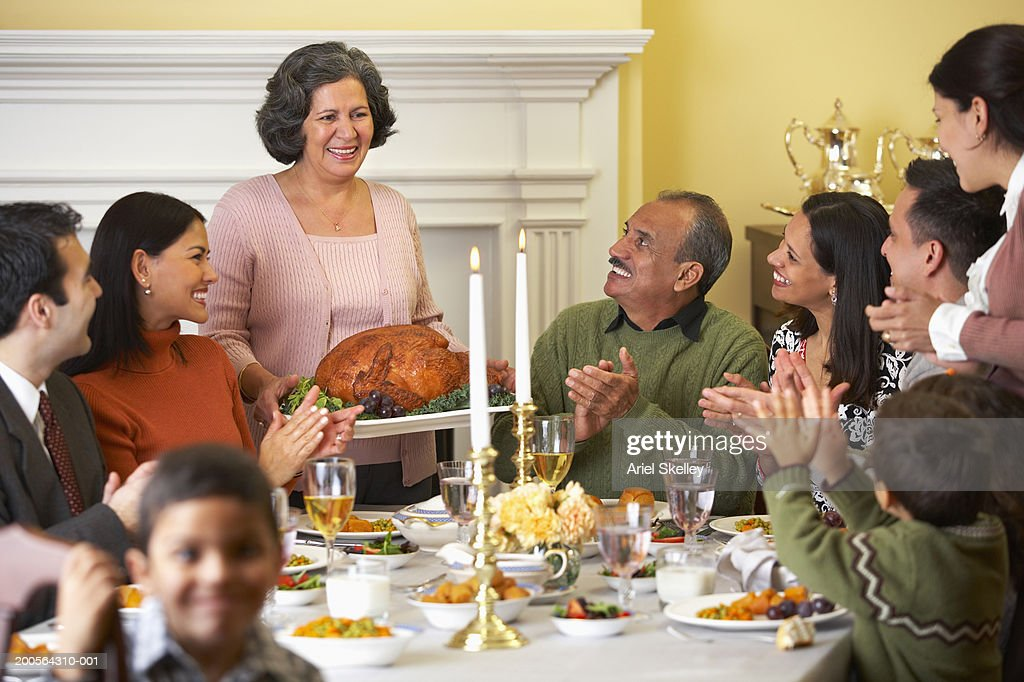 Family At Thanksgiving Dinner Table Stock Photo Getty Images