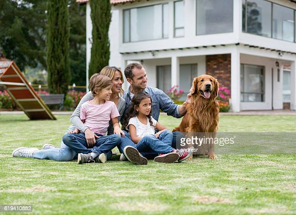 Family at the park playing with their dog