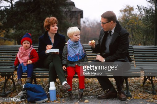 Family autumn picnic on park bench : Stock Photo