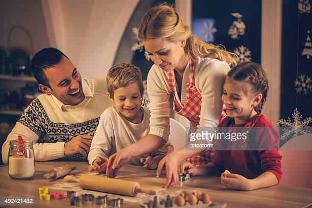 Family baking cookies for Christmas together