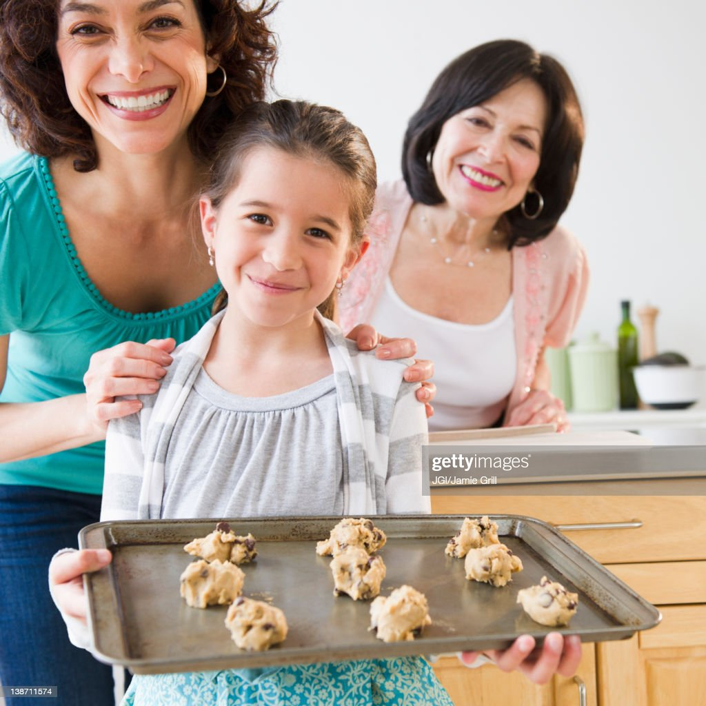 Family baking cookies together : Stock Photo