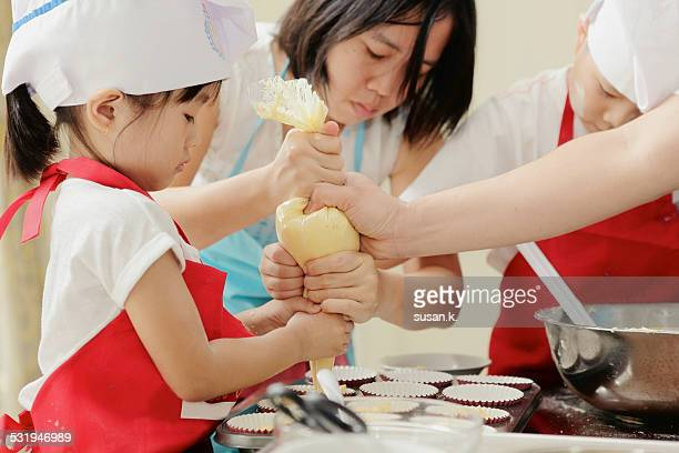 Family baking muffin together
