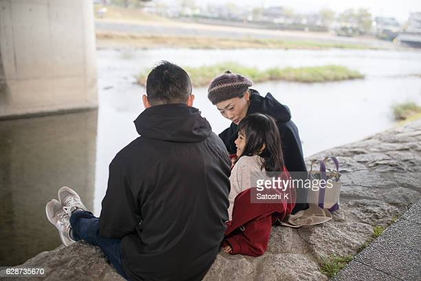 Family being relaxed under bridge