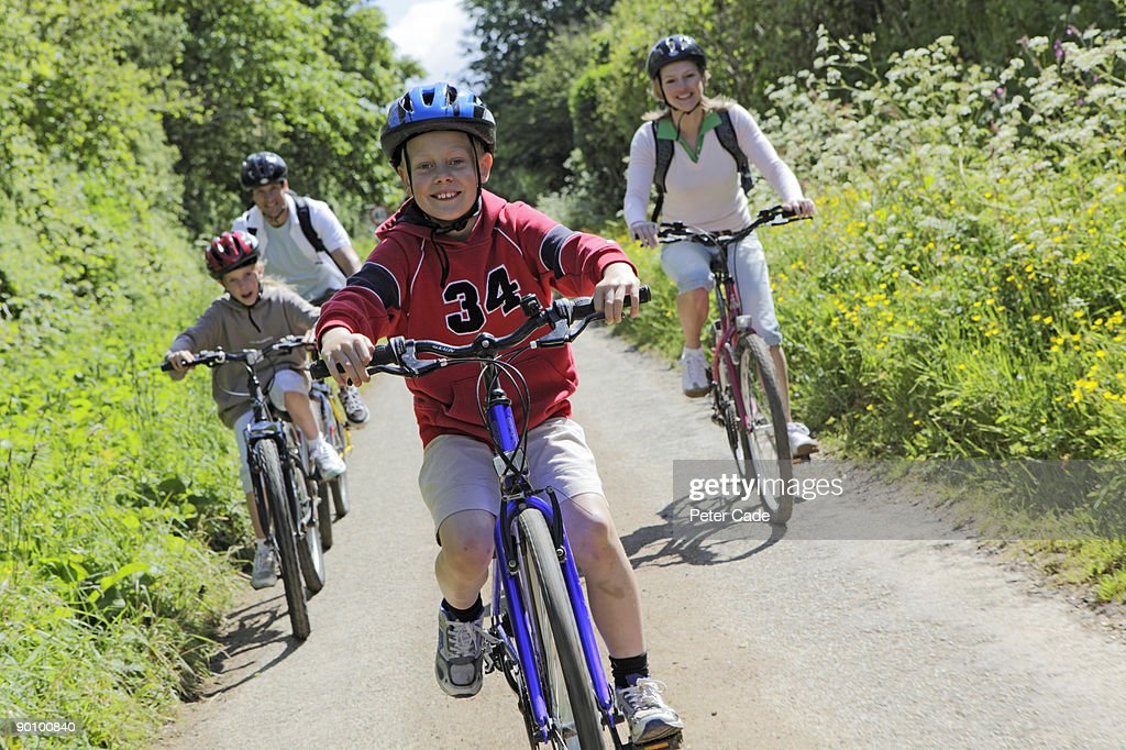 family bike ride in country : Stock Photo
