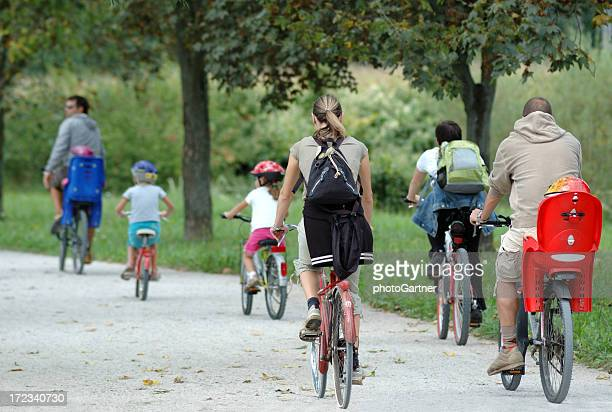 A family biking together in a park