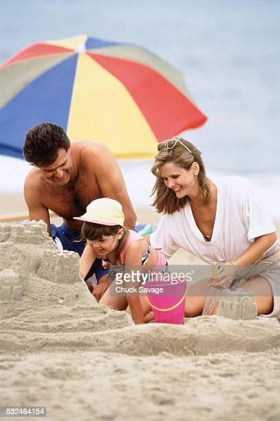 Family building a sand castle