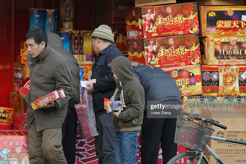 A family buys fireworks for the Chinese New Year, after specialty stores started selling them in Beijing on January 22, 2012 in Beijing, China. The Chinese Lunar New Year, known as the Spring Festival, is based on the Lunisolar Chinese calendar. It is celebrated from the first day of the first month of the lunar year and ends with the Lantern Festival on the fifteenth day.