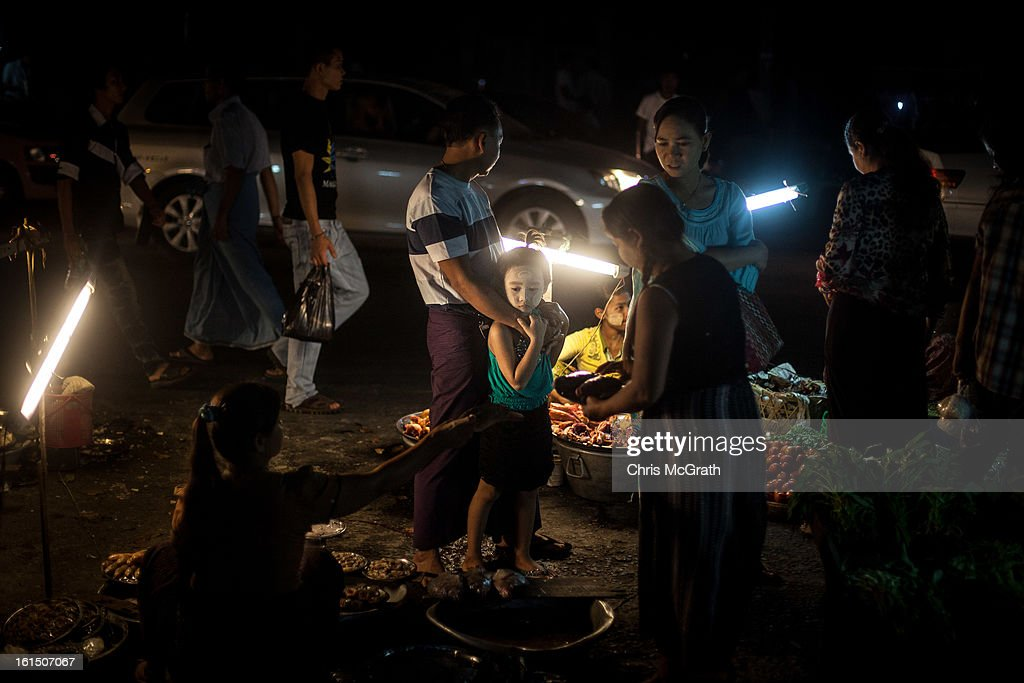 A family buys fish from a market stall February 10, 2013 in Yangon, Burma. Myanmar is going through rapid political and economic reforms initiated by the countries first civilian president Thein Sein after years of military junta rule.