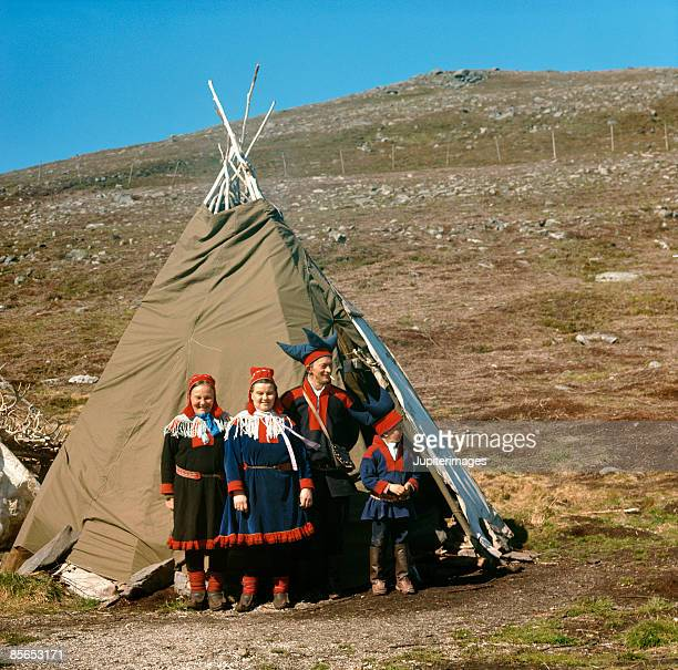 Family by tepee , Norway