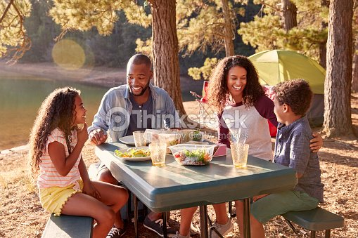 Family Camping By Lake On Hiking Adventure In Forest : Stock Photo