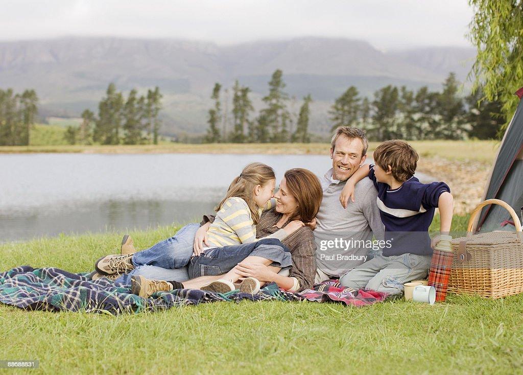 Family camping near lake : Stock Photo