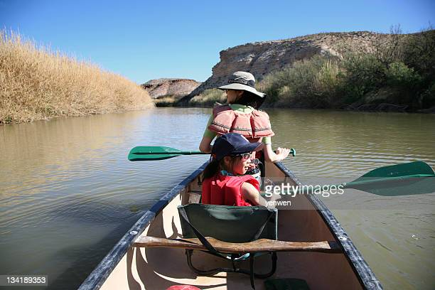 Family Canoeing in River