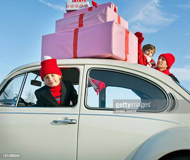 Family car with presents balanced on the roof