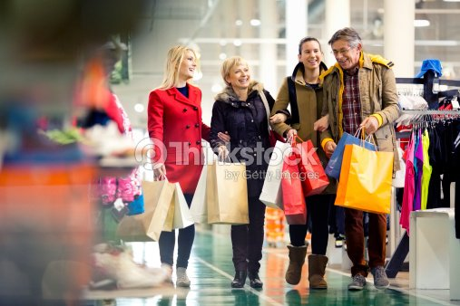 Family carrying shopping bags in mall stock photo thinkstock - Centro comercial moda shoping ...