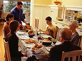 Family carving thanksgiving dinner