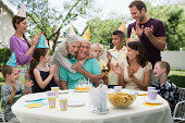 Family celebraring grandfather's birthday