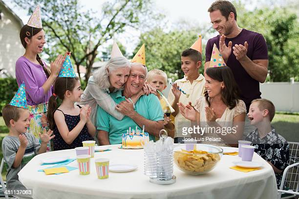 Family celebraring grandfather's birthday