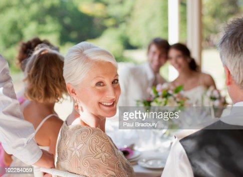 Family celebrating at wedding reception