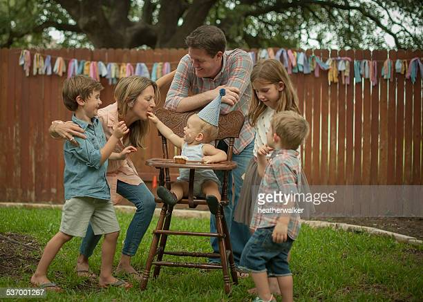 USA, Texas, Williamson county, Family celebrating birthday in back yard