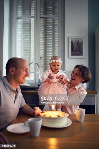 Family celebrating first birthday at home