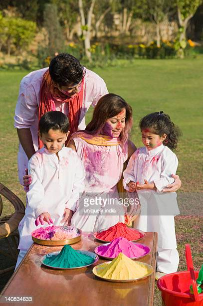 Family celebrating Holi in a garden