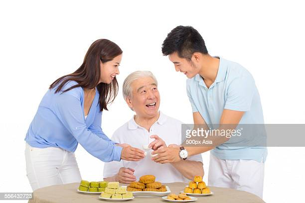 Family Celebrating Mid-Autumn Festival Happily