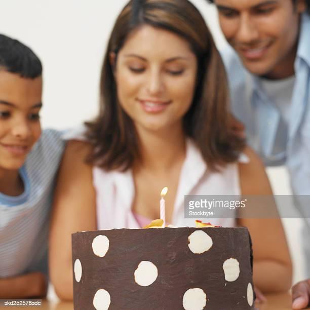 Family celebrating mother's birthday