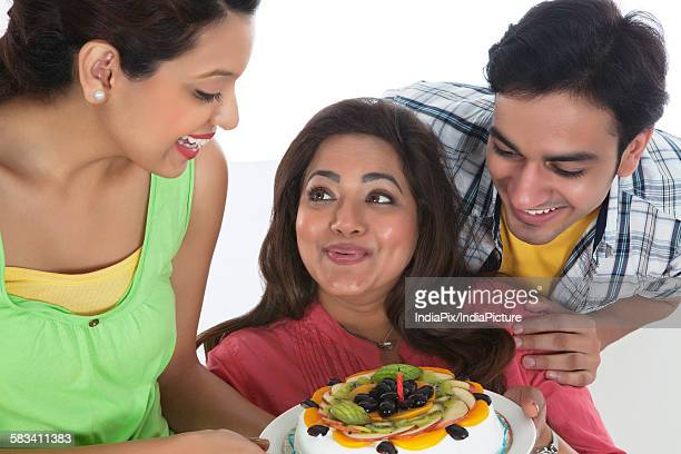 Family celebrating mothers day with cake