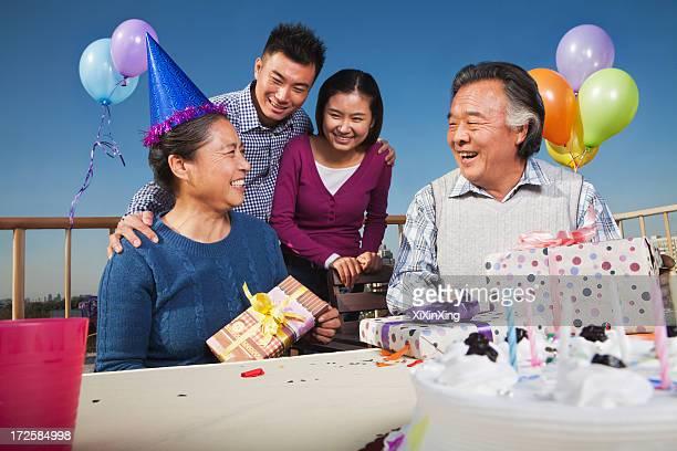 Family celebrating mum's birthday