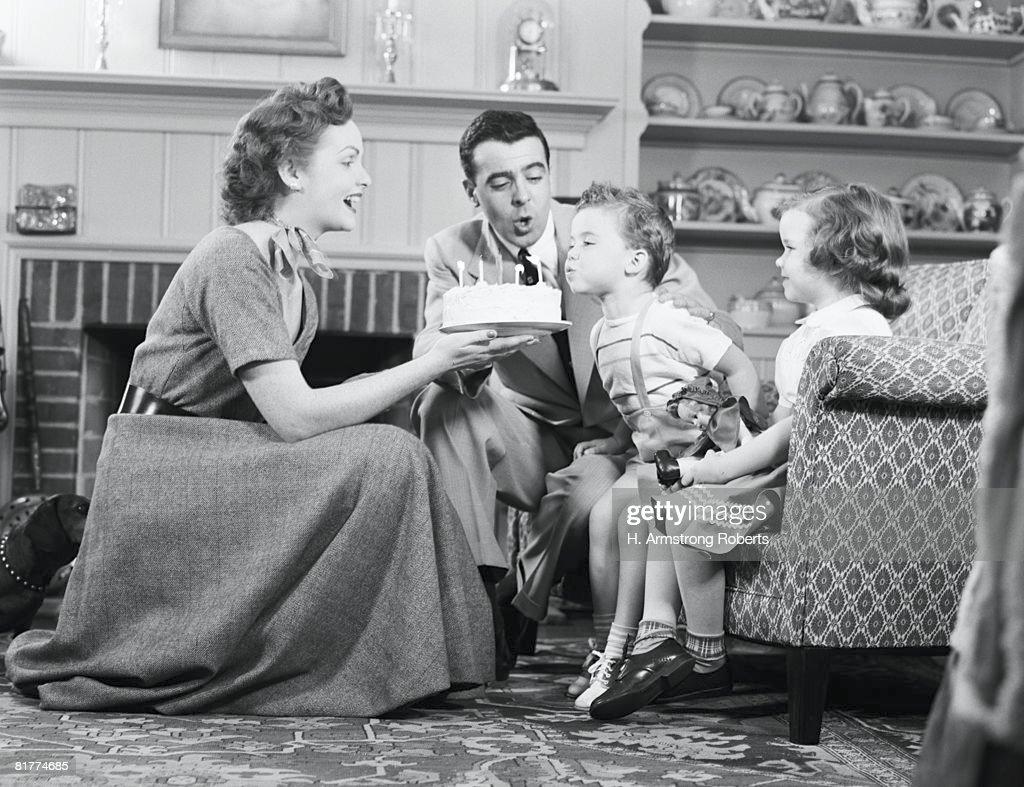 Family celebrating son's birthday. : Stock Photo
