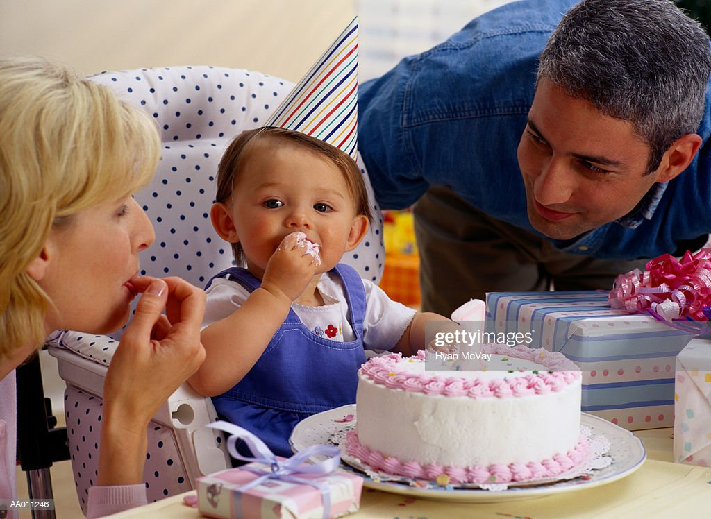 Family Celebrating Their Daughter's First Birthday