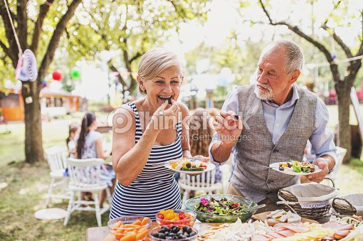 Family celebration or a garden party outside in the backyard. : Stock Photo