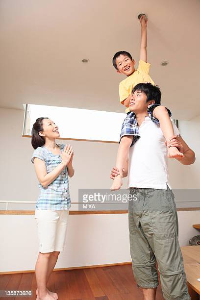 Family changing light bulb together