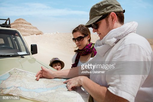 Family checking a map : Stock Photo