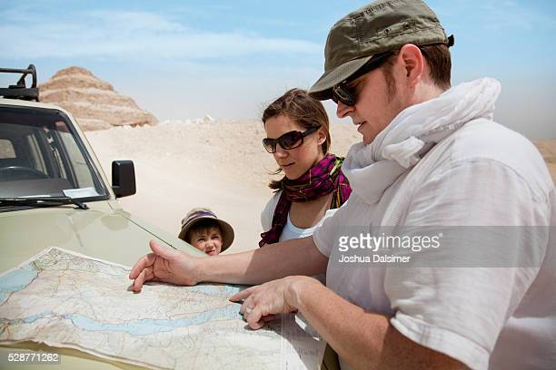 Family checking a map