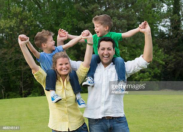 Family cheering in park