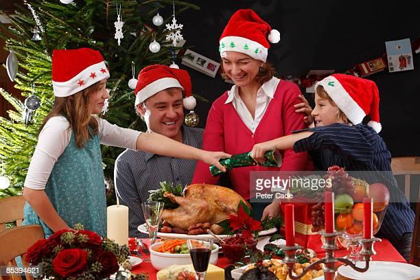Family christmas dinner pulling cracker