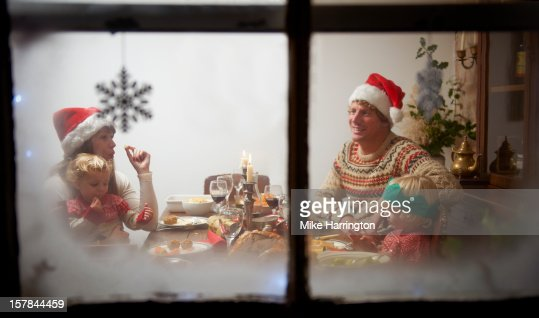 Family Christmas dinner through frosted glass. : Stock Photo