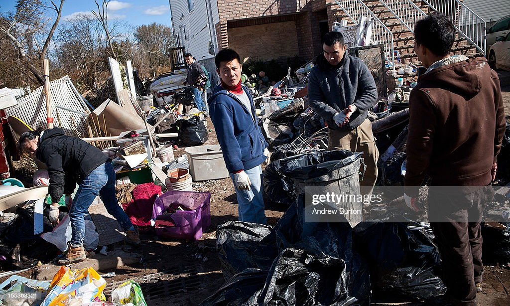 A family cleans out their home the Midland Beach neighborhood of Staten Island on November 3, 2012 in New York City. As clean up efforts from Superstorm Sandy continue, colder weather and another storm predicted for next week are beginning to make some worried.
