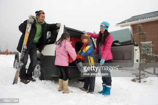 A family collects their ski gear