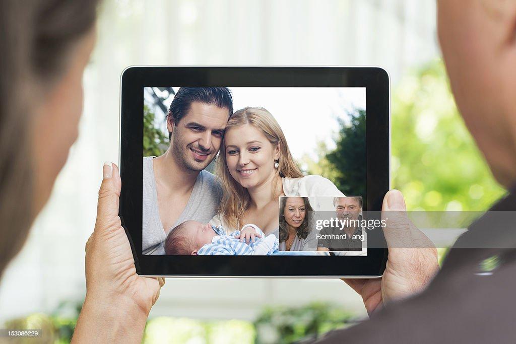 Family communicating via tablet : Stock Photo