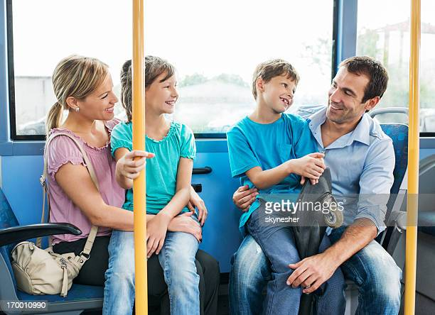 Family commuting by bus.