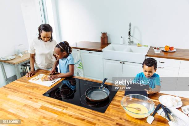 Family cooking breakfast together in kitchen