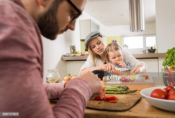 Family cooking in kitchen at home