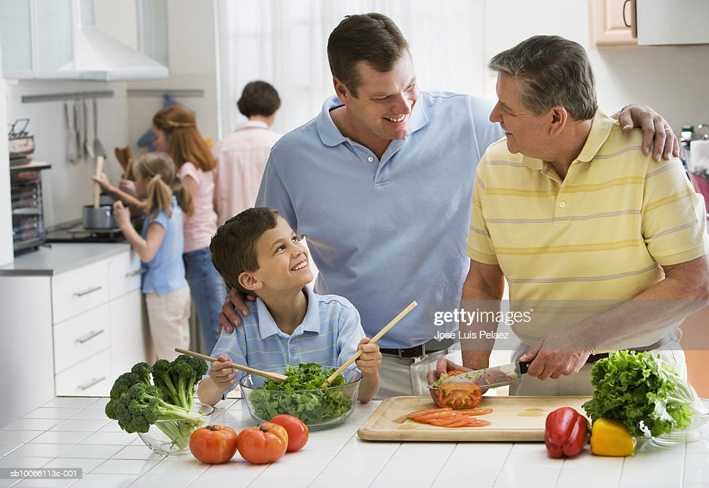 Family cooking in kitchen : Stock Photo