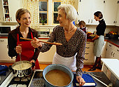 Family Cooking Mashed Potatoes and Gravy