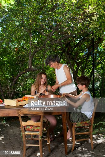 Family cooking outside : Stock Photo